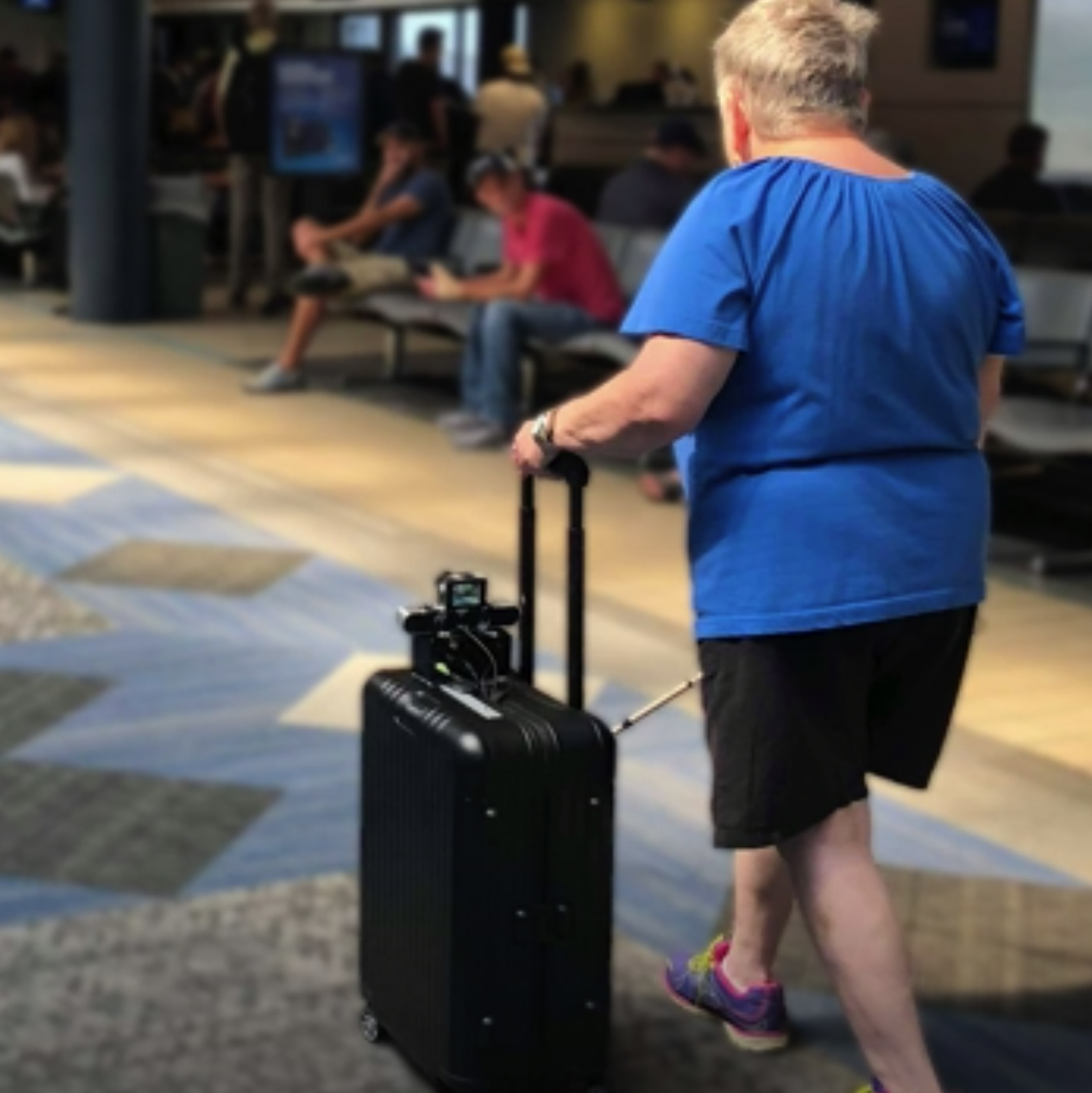 Blind woman with suitcase in airport