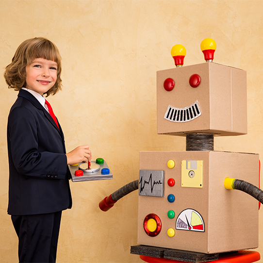 Young boy with robot